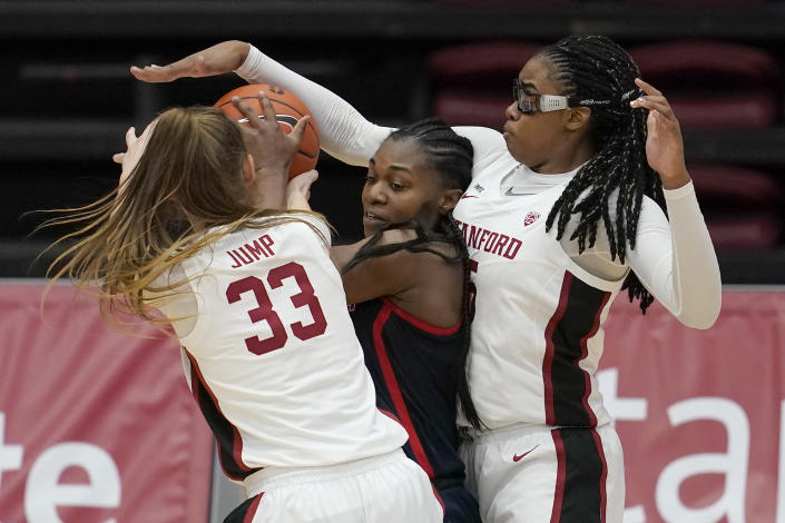 Arizona forward Trinity Baptiste, middle, is defended by Stanford guard Hannah Jump (33) and forward Francesca Belibi during the first half of an NCAA college basketball game in Stanford, Calif., Monday, Feb. 22, 2021. (AP Photo/Jeff Chiu)