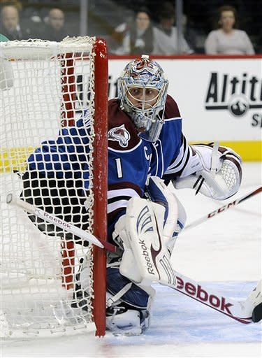 Colorado Avalanche goalie Semyon Varlamov, of Russia, watches the puck in the second period of an NHL hockey game against the San Jose Sharks on Sunday, March 10, 2013, in Denver.  (AP Photo/Chris Schneider)