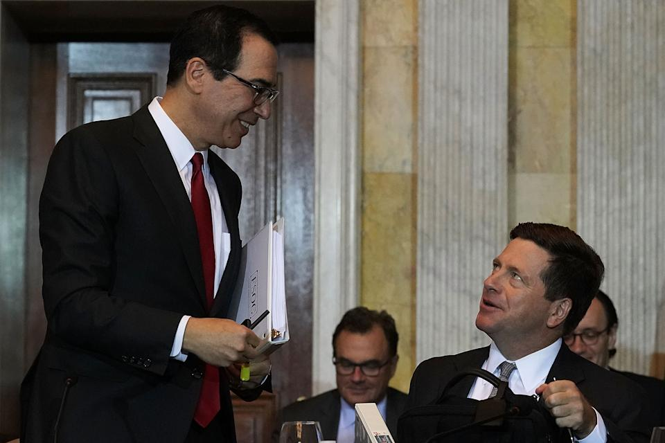 WASHINGTON, DC - OCTOBER 16:  U.S. Secretary of the Treasury Steven Mnuchin (L) talks to Chairman of Securities and Exchange Commission Jay Clayton (R) during a Financial Stability Oversight Council meeting October 16, 2018 at the Treasury Department in Washington, DC.  (Photo by Alex Wong/Getty Images)