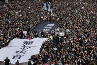 """Protesters carry a huge banner that reads """"Our hearts are torn to pieces. Withdraw the monstrous bill"""" as they march on the streets against an extradition bill in Hong Kong on Sunday, June 16, 2019. Hong Kong residents Sunday continued their massive protest over an unpopular extradition bill that has highlighted the territory's apprehension about relations with mainland China, a week after the crisis brought as many as 1 million into the streets. (AP Photo/Vincent Yu)"""