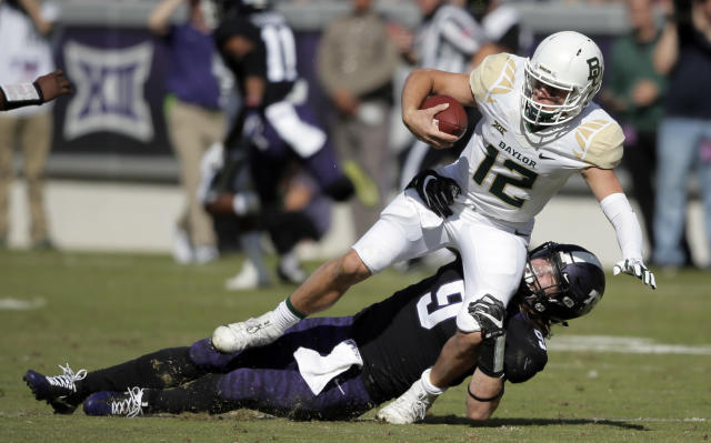 "TCU defensive end <a class=""link rapid-noclick-resp"" href=""/ncaaf/players/225939/"" data-ylk=""slk:Mat Boesen"">Mat Boesen</a> (9) leads the Big 12 in sacks. His teammate, <a class=""link rapid-noclick-resp"" href=""/ncaaf/players/238909/"" data-ylk=""slk:Ben Banogu"">Ben Banogu</a>, is second. (AP Photo/Brandon Wade, File)"