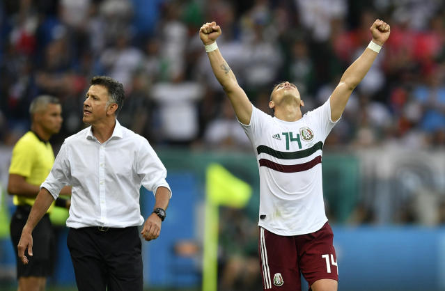 Mexico's Javier Hernandez celebrates beside Mexico head coach Juan Carlos Osorio, left, at the end of the group F match between Mexico and South Korea at the 2018 soccer World Cup in the Rostov Arena in Rostov-on-Don, Russia, Saturday, June 23, 2018. (AP Photo/Martin Meissner)