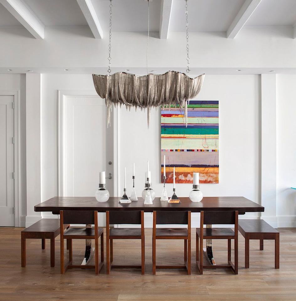 """<p>Looking for an easy way to incorporate a dose of style into your holiday table? Pair white candles with striking, sculptural holders, as designer <a href=""""https://www.carawoodhouse.com/"""" target=""""_blank"""">Cara Woodhouse</a> has done in this dining room. """"The best way to add drama to a traditional holiday table is to layer in candles at different heights and sizes that create depth and interest in an otherwise mundane design,"""" she says. """"The ambience that beautifully placed candles can add to a table setting is the difference in an unmemorable meal and an unforgettable gathering.""""</p>"""