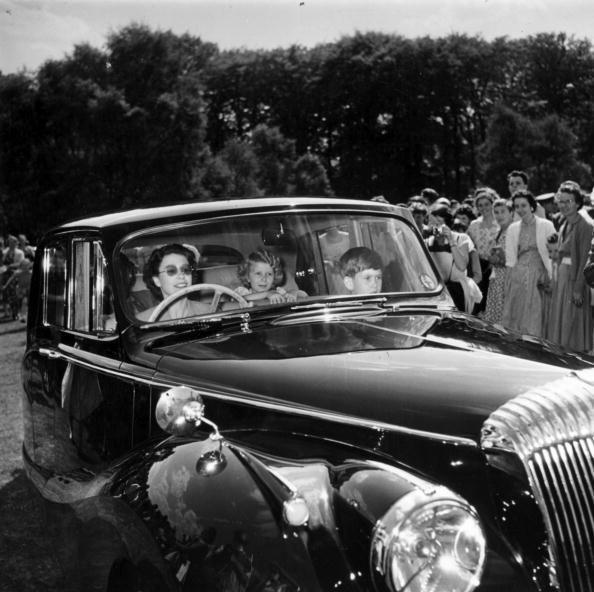 """<p>Queen Elizabeth II <a href=""""https://www.townandcountrymag.com/society/tradition/news/a8148/queen-elizabeth-car-auction/"""" rel=""""nofollow noopener"""" target=""""_blank"""" data-ylk=""""slk:takes a ride"""" class=""""link rapid-noclick-resp"""">takes a ride</a> with Prince Charles and Princess Anne as passengers.</p>"""