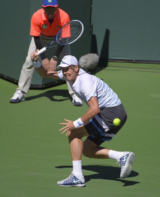 Tomas Berdych, of the Czech Republic, makes a return against Roberto Bautista Agut, of Spain, in a match at the BNP Paribas Open tennis tournament on Sunday, March 9, 2014, in Indian Wells, Calif. Berdych lost the match 4-6, 6-2, 6-4. (AP Photo/Mark J. Terrill)