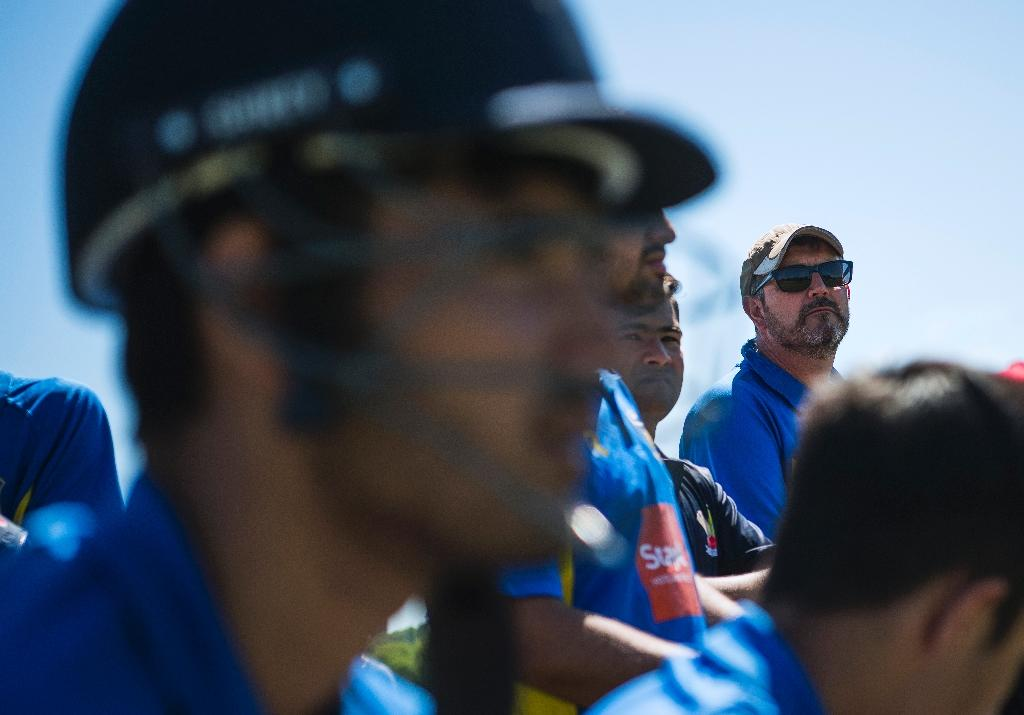 Under-19s cricket coach David Williman (R) is helping young migrants to Sweden from Afghanistan and Pakistan to improve their game (AFP Photo/Jonathan NACKSTRAND)