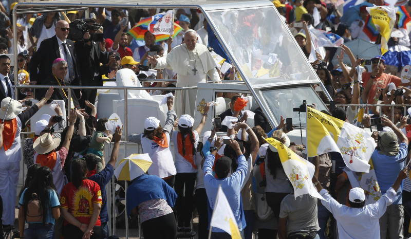 Pope Francis waves as he arrives to celebrate Mass on Lobito Beach in Iquique, Chile, Thursday, Jan. 18, 2018. (AP Photo/Juan Karita)