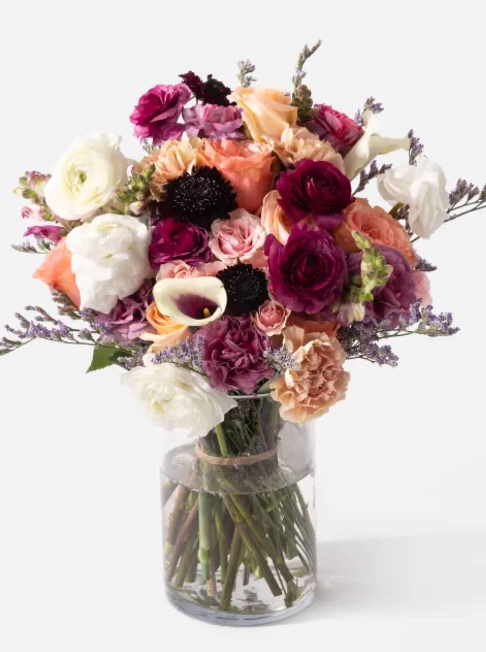 "Calla lilies, sprigs of snapdragons, and a mix of pink and peach roses make this UrbanStems bouquet dramatic in a good way. Search by delivery date to make sure your gift arrives on time—bonus points if you pair it with a <a href=""https://www.glamour.com/gallery/cool-vases?mbid=synd_yahoo_rss"" rel=""nofollow noopener"" target=""_blank"" data-ylk=""slk:cool vase"" class=""link rapid-noclick-resp"">cool vase</a> and <a href=""https://www.glamour.com/gallery/best-winter-candles?mbid=synd_yahoo_rss"" rel=""nofollow noopener"" target=""_blank"" data-ylk=""slk:candle"" class=""link rapid-noclick-resp"">candle</a>. $150, The Manhattan. <a href=""https://urbanstems.com/products/flowers/the-manhattan/FLRL-B-00010.html"" rel=""nofollow noopener"" target=""_blank"" data-ylk=""slk:Get it now!"" class=""link rapid-noclick-resp"">Get it now!</a>"