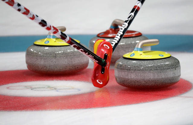 Replace these curling stones with babies, and you've got yourself an instant Winter Olympics phenomenon. (AP)