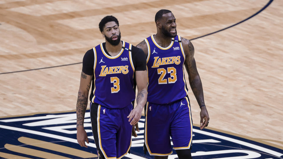 Los Angeles Lakers forward Anthony Davis (3) and forward LeBron James (23) during a timeout in the second quarter of an NBA basketball game against the New Orleans Pelicans in New Orleans, Sunday, May 16, 2021. (AP Photo/Derick Hingle)