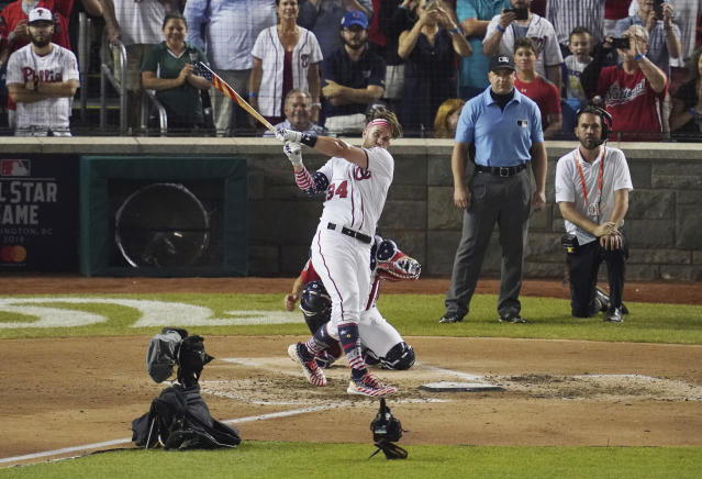 Washington Nationals Bryce Harper hits the winning home run during the Major League Baseball Home Run Derby, Monday, July 16, 2018 in Washington. The 89th MLB baseball All-Star Game will be played Tuesday. (AP Photo/Carolyn Kaster)