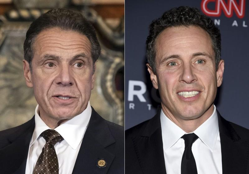 New York Gov. Andrew M. Cuomo, Cuomo appears during a news conference about the COVID-19 vaccine at the State Capitol in Albany, N.Y., on Dec. 3, 2020, left, and CNN anchor Chris Cuomo attends the 12th annual CNN Heroes: An All-Star Tribute at the American Museum of Natural History in New York on Dec. 9, 2018. CNN said it had reinstated a prohibition on Chris Cuomo interviewing or doing stories about his brother. The policy avoids a conflict of interest or at the very least the appearance of one. (Mike Groll/Office of Governor of Andrew M. Cuomo via AP, left, and Evan Agostini/Invision/AP)