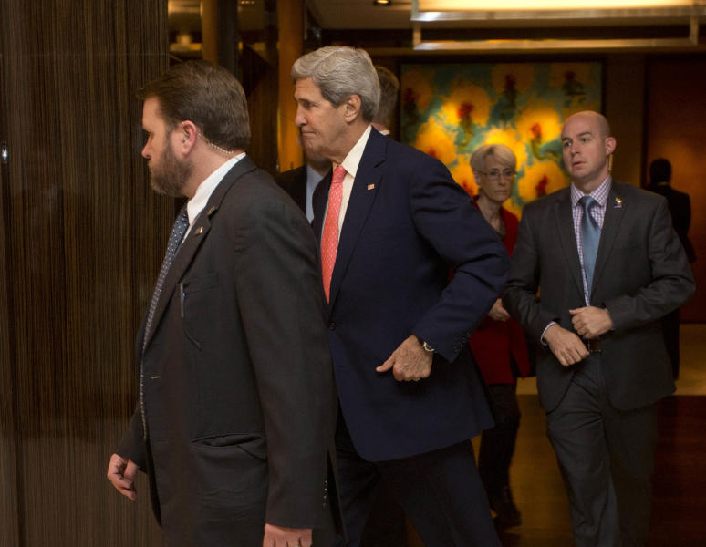 U.S. Secretary of State John Kerry, second left, arrives for a meeting with European Union's top diplomat Catherine Ashton before a second day of trilateral talks with Iranian Foreign Minister Mohammad Javad Zarif in Geneva, Saturday, Nov. 9, 2013. (AP Photo/Jason Reed, Pool)