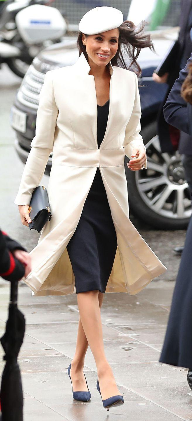 """<p>Markle and her fiancé accompanied the monarch at a special service to mark Commonwealth Day at Westminster Abbey. The bride-to-be was dressed in a <a href=""""https://www.amandawakeley.com/uk/cream-sculpted-tailoring-coat"""" rel=""""nofollow noopener"""" target=""""_blank"""" data-ylk=""""slk:white/cream Crombie coat"""" class=""""link rapid-noclick-resp"""">white/cream Crombie coat</a> by British fashion designer Amanda Wakeley, which she paired with a matching beret and the <a href=""""https://www.mulberry.com/gb/shop/women/bags/shoulder-bags/small-darley-bright-navy-cross-grain-leather"""" rel=""""nofollow noopener"""" target=""""_blank"""" data-ylk=""""slk:Mulberry 'Small Darley' clutch bag"""" class=""""link rapid-noclick-resp"""">Mulberry 'Small Darley' clutch bag</a> in bright navy.</p>"""