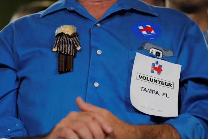 Larry Potter, Clinton volunteer wears a Hillary Clinton doll on his shirt at a campaign Voter Registration Rally at the University of South Florida in Tampa, Florida on September 6, 2016. (Photo: Brian Snyder/Reuters)