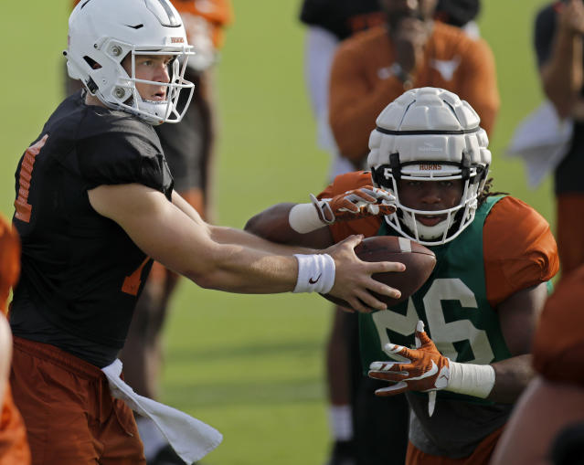 Texas Longhorns' Sam Ehlinger (left) hands off to Keaontay Ingram during practice Wednesday Sept. 4, 2019 in Austin, Tx. ( Photo by Edward A. Ornelas )