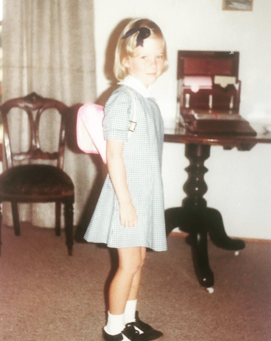 Samantha Armytage wearing a green uniform on her first day at Adaminaby Public School in 1982