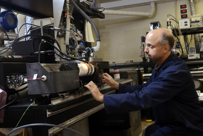 In this Aug. 28, 2013 photo, Todd Griffin, Kodak print head engineer, makes a demo print with a high speed drum at Kodak research labs in Rochester, N.Y. The print will be used to investigate the quality of new ink sets. This is part of the new materials development for flexographic printing plates. (AP Photos/Heather Ainsworth)