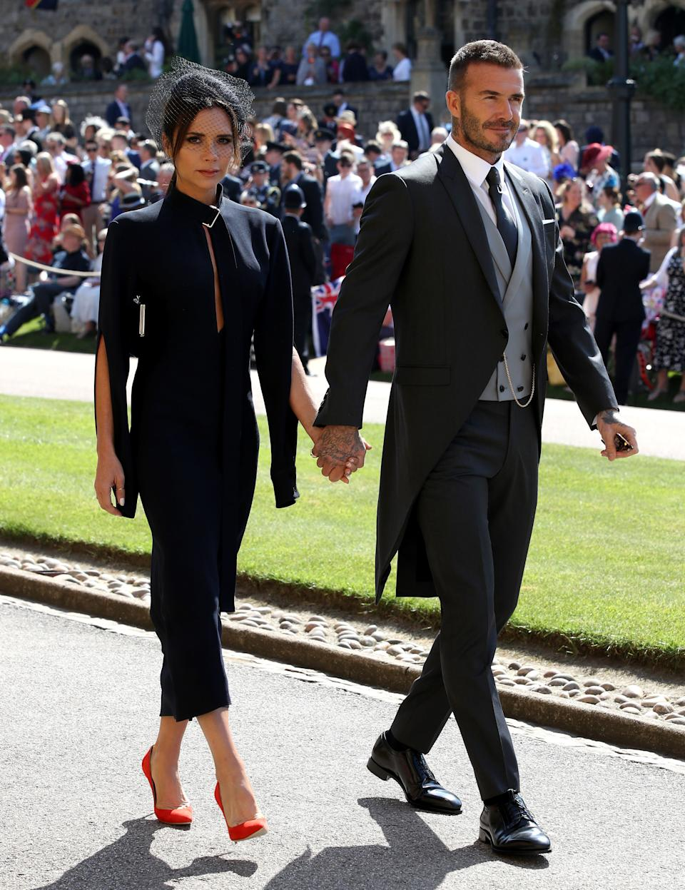 David and Victoria Beckham famously bagged an invite to the Duke and Duchess of Sussex's nuptials [Photo: Getty]