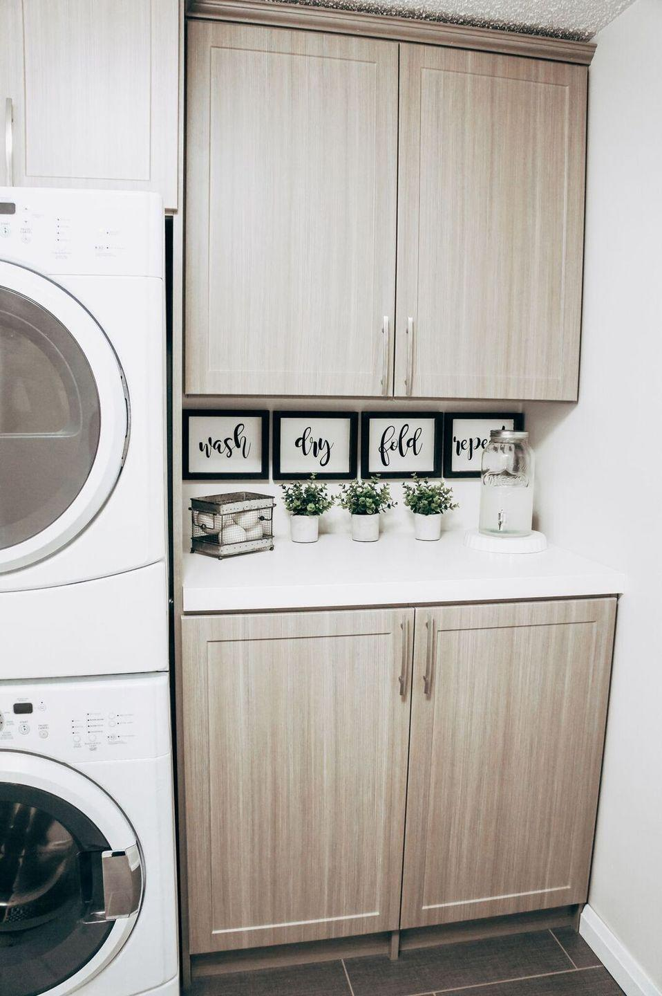 "<p>You'll be pleased to know that you can make these absolutely adorable farmhouse signs for your laundry room with artist panels scored at the dollar store. </p><p><strong>Get the tutorial at <a href=""https://www.robynjohanna.com/diy-dollar-store-farmhouse-sign/"" rel=""nofollow noopener"" target=""_blank"" data-ylk=""slk:Robyn Johanna"" class=""link rapid-noclick-resp"">Robyn Johanna</a>.</strong></p><p><a class=""link rapid-noclick-resp"" href=""https://www.amazon.com/gp/product/B017NNJQWE/?tag=syn-yahoo-20&ascsubtag=%5Bartid%7C10050.g.31153820%5Bsrc%7Cyahoo-us"" rel=""nofollow noopener"" target=""_blank"" data-ylk=""slk:SHOP WOOD STAIN"">SHOP WOOD STAIN</a></p>"