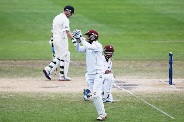 DUNEDIN, NEW ZEALAND - DECEMBER 07: Denesh Ramdin of the West Indies catches Brendon McCullum of New Zealand out during day five of the first test match between New Zealand and the West Indies at University Oval on December 7, 2013 in Dunedin, New Zealand. (Photo by Hannah Johnston/Getty Images)