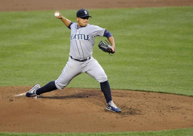 Seattle Mariners starting pitcher Erasmo Ramirez delivers a pitch against the Baltimore Orioles during the third inning of a baseball game, Saturday, Aug. 3, 2013, in Baltimore. (AP Photo/Nick Wass)