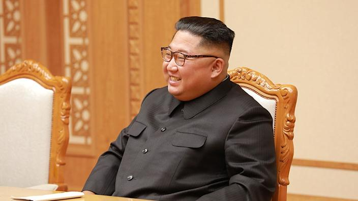 State media said Kim warned against a hasty relaxing of restrictions
