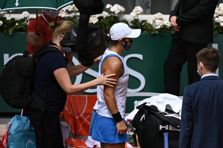 Over and out: Top seed Australia's Ashleigh Barty had to retire from her second round match against Magda Linette