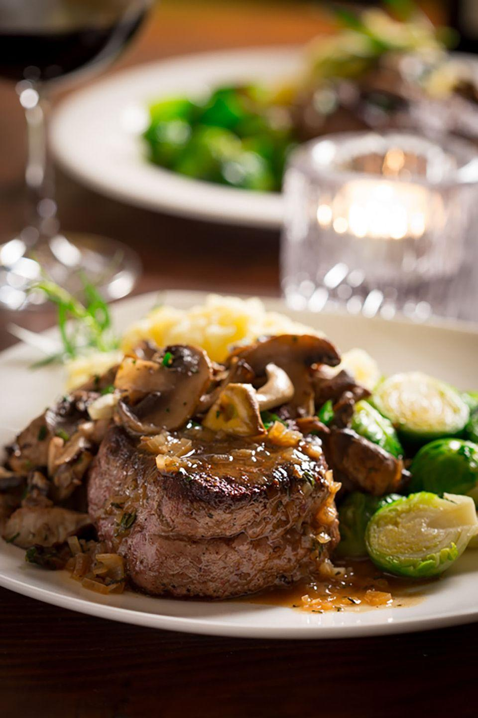 """<p><span class=""""redactor-invisible-space"""">Sautéed mushrooms and a savory sauce make this seared crust of filet mignon taste oh-so-good.</span></p><p><strong>Get the recipe at <a href=""""http://www.healthyseasonalrecipes.com/big-sexy-steaks-tarragon-mushrooms/"""" rel=""""nofollow noopener"""" target=""""_blank"""" data-ylk=""""slk:Healthy Seasonal Recipes"""" class=""""link rapid-noclick-resp"""">Healthy Seasonal Recipes</a>. </strong> </p>"""