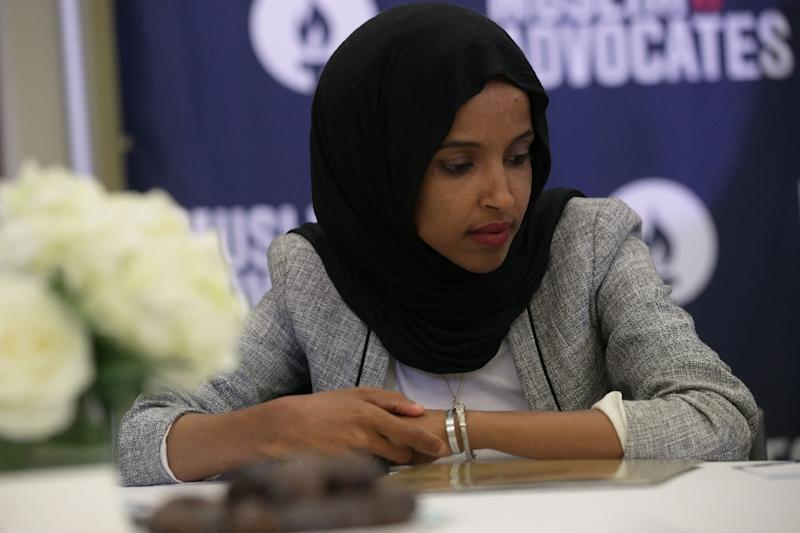 US House Representative Ilhan Omar listens to remarks during a congressional Iftar event on May 20, 2019