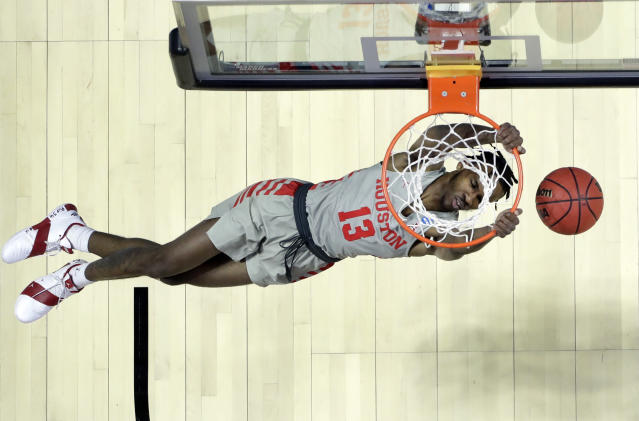 Houston's DeJon Jarreau dunks the ball during the first half of a first round men's college basketball game against Georgia State in the NCAA Tournament Friday, March 22, 2019, in Tulsa, Okla. (AP Photo/Jeff Roberson)