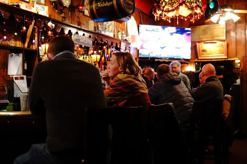 FILE PHOTO: People drink and socialize inside the Swingin Door Exchange, as the coronavirus disease (COVID-19) outbreak continues in Milwaukee