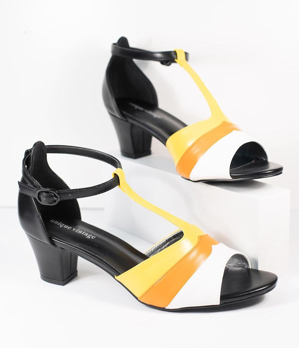 <p>There's nothing sweeter than these <span>Unique Vintage Candy Corn T-Strap Charisse Heels</span> ($62). </p>