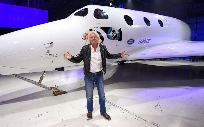 Sir Richard Branson unveiling the SpaceShipTwo passenger rocket - AP