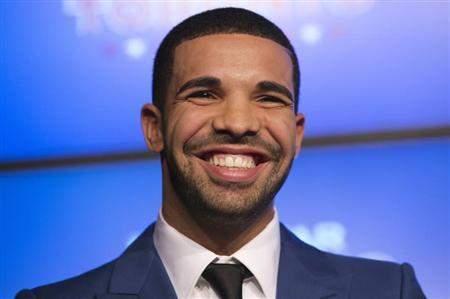 Drake smiles during an announcement that the Toronto Raptors will host the NBA All-Star game in Toronto