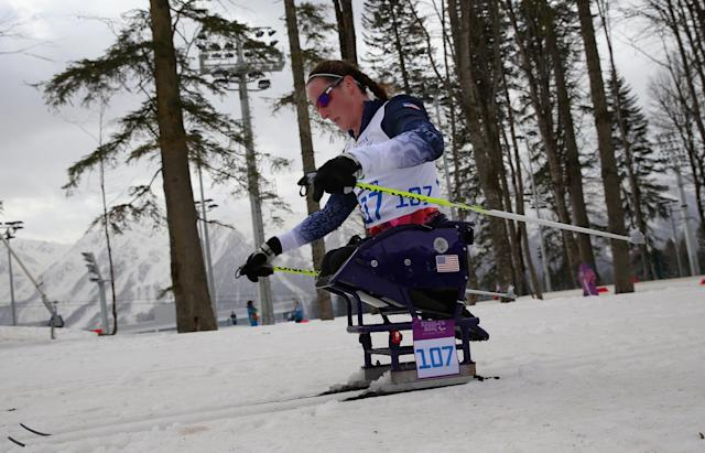 SOCHI, RUSSIA - MARCH 09: Tatyana McFadden of USA competes in the Women's 12km Sitting Cross-Country Skiing event during day two of Sochi 2014 Paralympic Winter Games at Laura Cross-country Ski & Biathlon Center on March 9, 2014 in Sochi, Russia. (Photo by Ronald Martinez/Getty Images)