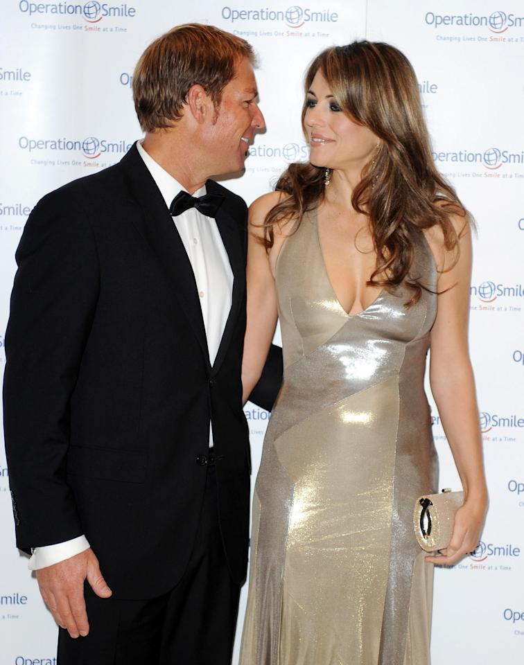 LONDON, UNITED KINGDOM - NOVEMBER 10:  Shane Warne and Elizabeth Hurley attend the Operation Smile Ball - 10th Anniversary at the Hurlingham Club, Ranelagh Gardens on November 10, 2011 in London, United Kingdom. (Photo by Olga Bermejo/Getty Images)