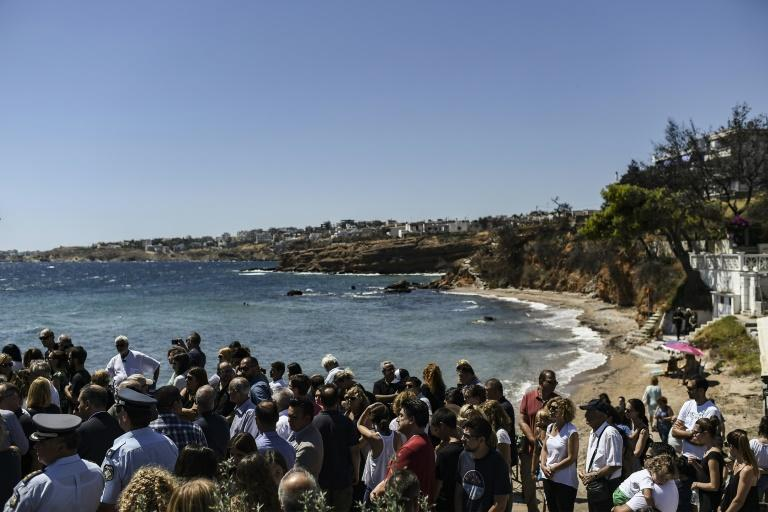 People gathered on the beach Sunday for a memorial ceremony in memory of the victims of the wildfire