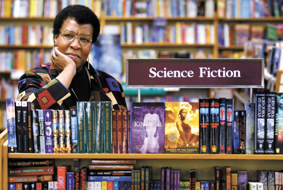 FILE - In this Feb. 4, 2004 file photo, science fiction writer Octavia Butler poses for a portrait near some of her novels at University Book Store in Seattle, Wash. On Friday, March 5, 2021, scientists announced that they've named the touchdown site of the Perseverance Mars rover in honor of the late writer, who grew up next door to the Jet Propulsion Laboratory in Pasadena. She was one of the first African Americans to receive mainstream attention for science fiction. (Joshua Trujillo/seattlepi.com via AP)