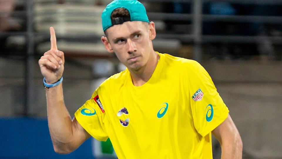 Alex De Minaur, pictured here in action against Rafael Nadal at the ATP Cup.