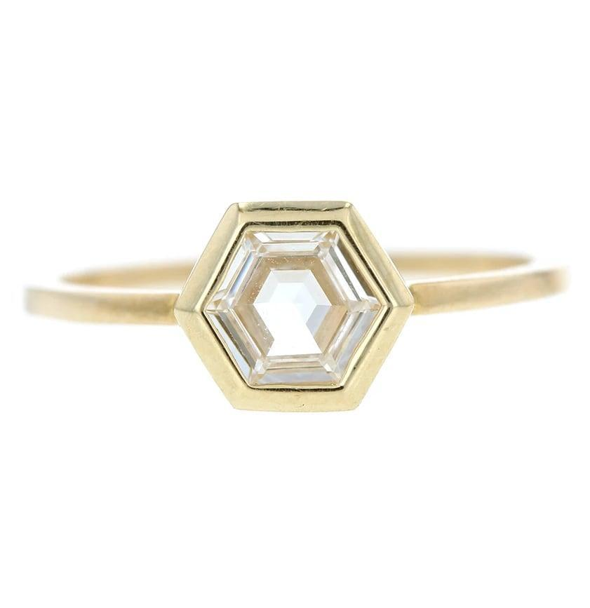 """<p>Uniquely shaped rings are taking over the new year, meaning sparklers like this <a href=""""https://www.popsugar.com/buy/Grace-Lee-Hex-Step-Cut-Diamond-Ring-533233?p_name=Grace%20Lee%20Hex%20Step%20Cut%20Diamond%20Ring&retailer=gracelee.com&pid=533233&price=5%2C800&evar1=fab%3Aus&evar9=47015200&evar98=https%3A%2F%2Fwww.popsugar.com%2Ffashion%2Fphoto-gallery%2F47015200%2Fimage%2F47015998%2FHexagons-Grace-Lee-Hex-Step-Cut-Diamond-Ring&list1=shopping%2Cjewelry%2Crings%2Cengagement%20rings&prop13=mobile&pdata=1"""" rel=""""nofollow noopener"""" class=""""link rapid-noclick-resp"""" target=""""_blank"""" data-ylk=""""slk:Grace Lee Hex Step Cut Diamond Ring"""">Grace Lee Hex Step Cut Diamond Ring</a> ($5,800) is sure to be seen on more than a handful of ring fingers.</p>"""