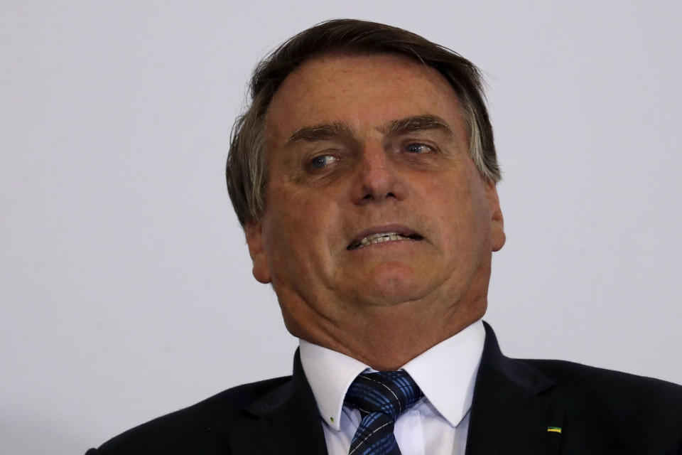 Brazil's President Jair Bolsonaro reacts during ceremony to present the government's agenda to the new elected mayors, at the Planalto Presidential Palace, in Brasilia, Brazil, Tuesday, Feb. 23, 2021. (AP Photo/Eraldo Peres)