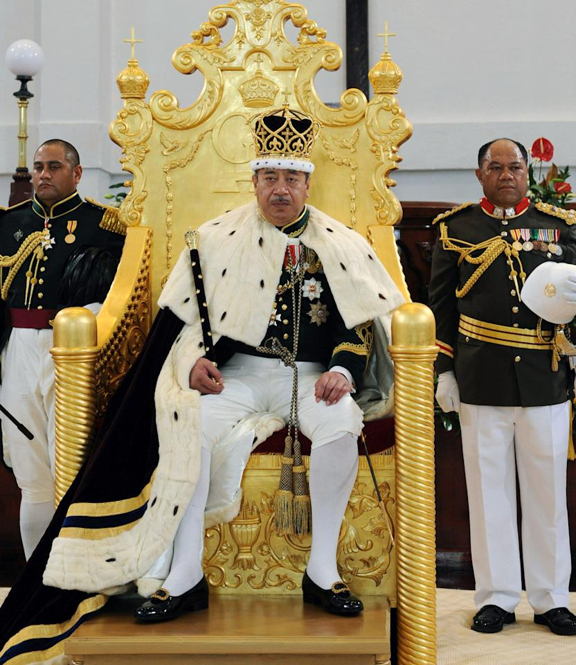 FILE - In this Aug. 1, 2008 file photo the King of Tonga George Tupou V sits on his throne in Nuku'aloka,Tonga. King George Tupou V, who championed a more democratic system of government in the Pacific island nation, died Sunday March 18, 2012, at a Hong Kong hospital. (AP Photo/New Zealand Herald, Glenn Jeffrey, File) NEW ZEALAND OUT, AUSTRALIA OUT