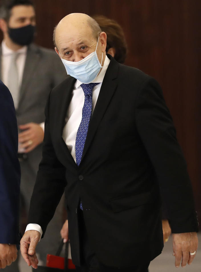 """French Foreign Minister Jean-Yves Le Drian, leaves the Presidential Palace after his meeting with Lebanese President Michel Aoun in Baabda, east of Beirut, Lebanon, Thursday, May 6, 2021. Le Drian began a visit to Lebanon Thursday with a message of """"great firmness"""" to its political leaders, threatening to take additional measures against officials obstructing the formation of a government in the crisis-hit country. (AP Photo/Hussein Malla)"""