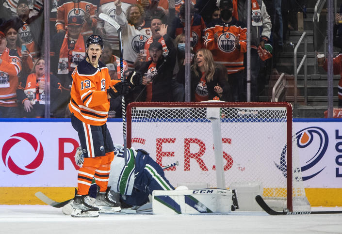 Vancouver Canucks' goalie Thatcher Demko (35) gives up a goal to Edmonton Oilers' Jesse Puljujarvi (13) during the first period of an NHL hockey game Wednesday, Oct. 13, 2021, in Edmonton, Alberta. (Jason Franson/The Canadian Press via AP)