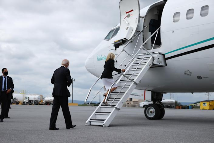 Democratic presidential nominee and former Vice President Joe Biden and Dr. Jill Biden board their airplane after visiting the Flight 93 National Memorial in Johnstown, Pennsylvania. / Credit: Chip Somodevilla / Getty Images