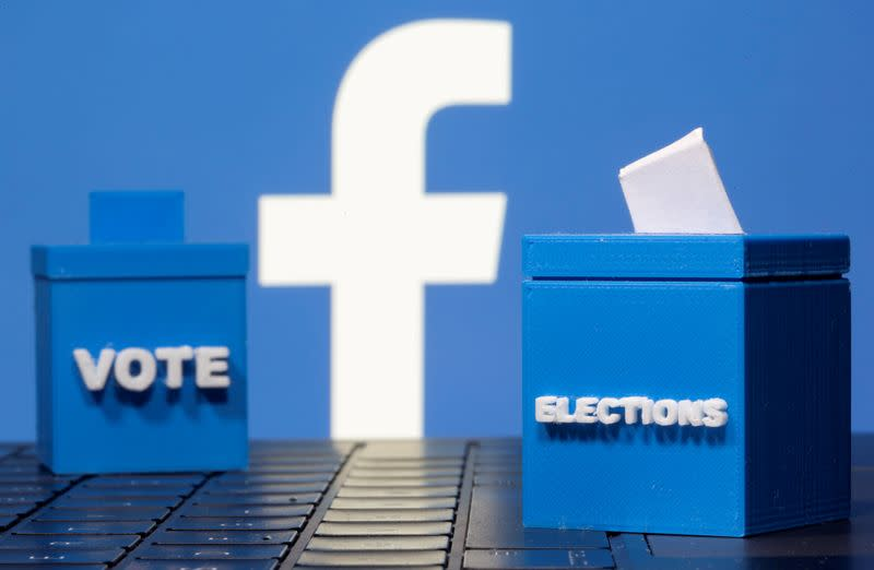 FILE PHOTO: 3D-printed ballot boxes are seen in front of a displayed Facebook logo