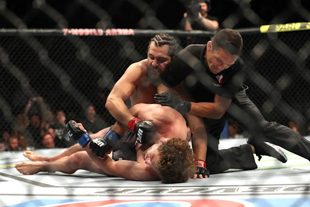 Jorge Masvidal is stopped by referee Jason Herzog from punching an unconscious Ben Askren at UFC 239 on Saturday in Las Vegas. (Getty Images)