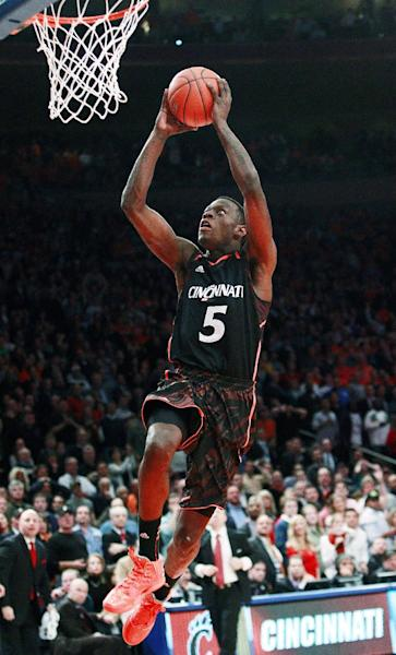 Cincinnati's Justin Jackson (5) dunks the ball during the second half of an NCAA college basketball game against Syracuse in the semifinals of the Big East Conference tournament in New York, Friday, March 9, 2012. Cincinnati won 71-68. (AP Photo/Frank Franklin II)