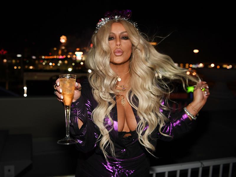 Aubrey O'Day claims flight attendant forced her to remove her shirt